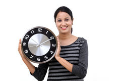 Young woman holding office clock Stock Photos