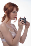 Young woman holding an old camera Royalty Free Stock Image
