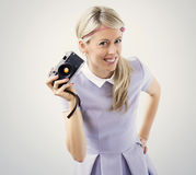 Young woman holding old film camera Stock Photo