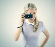 Young woman holding old film camera Stock Images