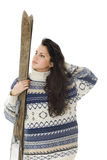 Young woman holding old wooden ski Royalty Free Stock Photography