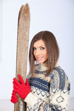 Young woman holding old wooden ski Royalty Free Stock Images