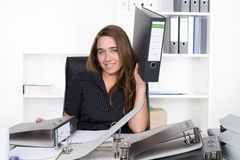 Young woman is holding one file up Stock Photography