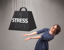 Young woman holding one ton of stress weight Stock Photography