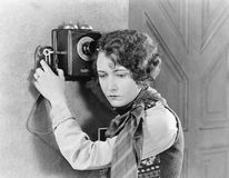 Young woman holding onto a telephone. (All persons depicted are no longer living and no estate exists. Supplier grants that there will be no model release Stock Photo