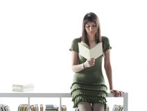 Young woman holding an open book Stock Photography