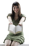 Young Woman holding an open book Royalty Free Stock Image