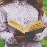 Young woman holding open book in her hands Stock Image