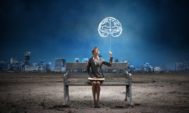 Free Young Woman Holding Open Book On Bench Royalty Free Stock Image - 160906156