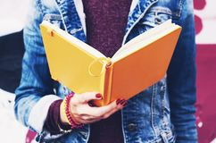 Student reading open copybook Royalty Free Stock Images