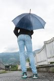 Young woman holding opened umbrella Stock Photos