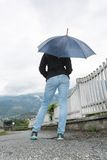 Young woman holding opened umbrella Royalty Free Stock Image