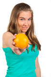Young woman holding a orange Stock Photo