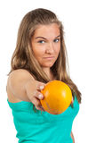Young woman holding a orange Royalty Free Stock Images