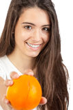 Young woman holding a orange Royalty Free Stock Image