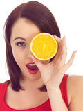 Young Woman Holding an Orange Royalty Free Stock Photography