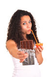 Young woman holding orange and chocolate. Isolated over white. I Royalty Free Stock Images