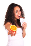 Young woman holding orange and chocolate.  over white. I Stock Photography