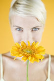 A Young Woman Holding An Orange Flower Stock Photography