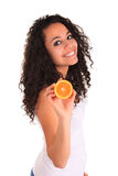 Young woman holding orange. Isolated over white Royalty Free Stock Images