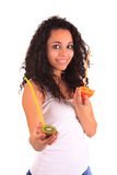 Young woman holding orange and kiwi. Isolated over white Stock Image