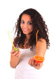 Young woman holding orange and kiwi. Isolated over white Royalty Free Stock Image