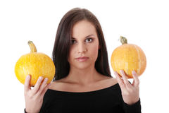 Young woman holding orange pumpkin Royalty Free Stock Images
