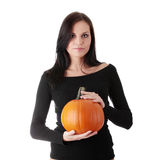 Young woman holding orange pumpkin Stock Image