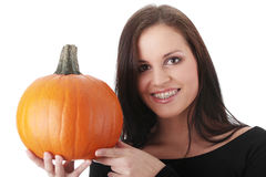 Young woman holding orange pumpkin Stock Photography