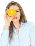 Young Woman Holding an Orange Stock Image