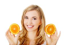 Young woman holding oranges Royalty Free Stock Photography