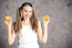 Young woman holding oranges stock photo