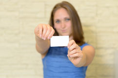 Young woman holding out a business card Stock Photography