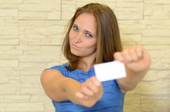 Young woman holding out a business card Stock Photo