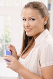 Young woman holding package of drugs Royalty Free Stock Images