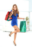 Young woman holding the packages Royalty Free Stock Photography