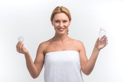 Young woman holding pad for face skin Royalty Free Stock Images