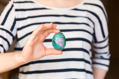 Young woman holding painted easter egg Royalty Free Stock Photos