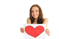 Young woman holding a painted heart Stock Images