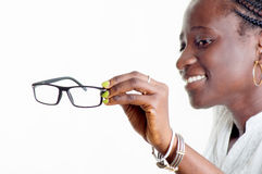 Young woman holding a pair of glasses. This young woman is happy with her new pair of glasses Stock Photo