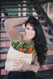 Young woman holding paper bag with ingredients for x-mas wreath Royalty Free Stock Photo