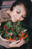 Young woman holding paper bag with ingredients for x-mas wreath Royalty Free Stock Photography