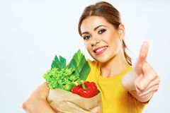 Young woman holding paper bag with vegetarian food. Stock Photos
