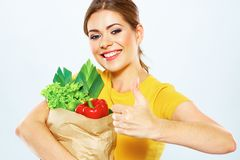 Young woman holding paper bag with vegetarian food. Royalty Free Stock Photo