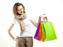 Young woman holding paper bags Royalty Free Stock Photos