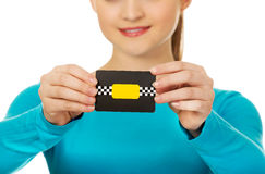 Young woman holding paper card. royalty free stock photos