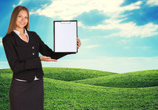 Young woman holding paper holder with nature on Stock Photography