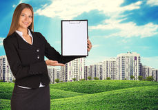 Young woman holding paper holder with nature and Stock Photo