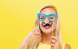 Young woman holding paper party sticks Royalty Free Stock Images