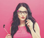 Young woman holding paper party sticks Stock Photography